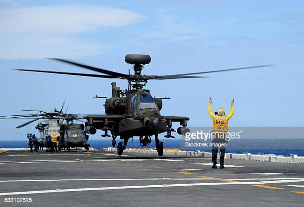 a u.s. army ah-64e apache guardian launches from uss peleliu. - apache helicopter stock pictures, royalty-free photos & images