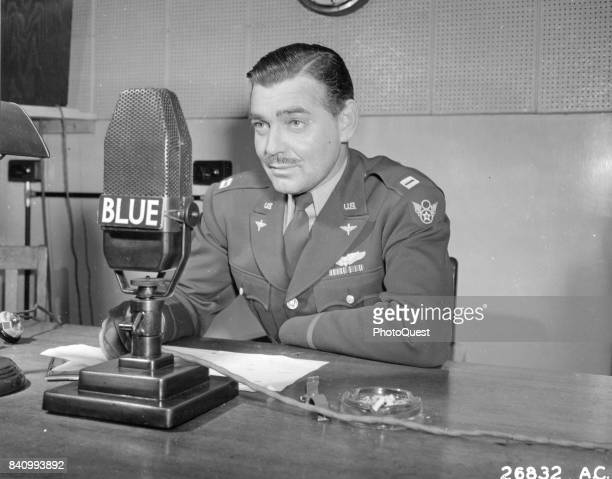 Army Air Corps Capt Clark Gable speaks into a microphone as he urges the purchase of War Bonds in support of the 3rd War Loan Drive program, England,...