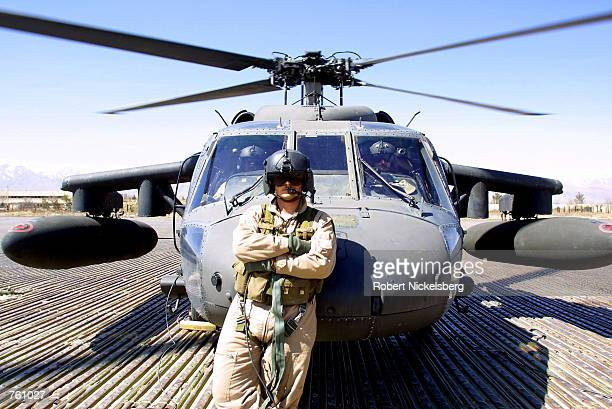 A US army air crewman from a Blackhawk helicopter waits for soldiers from the 10th Mountain Division to board during Operation Anaconda at Bagram Air...