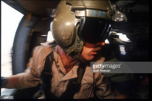 Army Airborne Ranger flies in a helicopter October 13 1993 in Mogadishu Somalia Two US Army Airborne Ranger''s helicopters were shot down October 3...