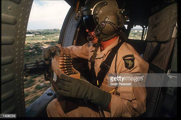 Army Airborne Ranger operates a machine gun October 13, 1993 in Mogadishu, Somalia. Two US Army Airborne Ranger''s helicopters were shot down October...