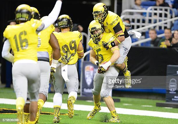 S Army AllAmerican Bowl West Team linebacker Porter Gustin is congratulated by US Army AllAmerican Bowl West Team linebacker Josh Barajas after...