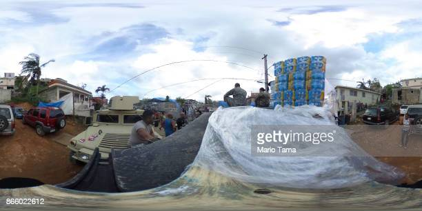 Army along with other troops deliver FEMA aid more than three weeks after Hurricane Maria hit the island, on October 17, 2017 in San Isidro, Puerto...