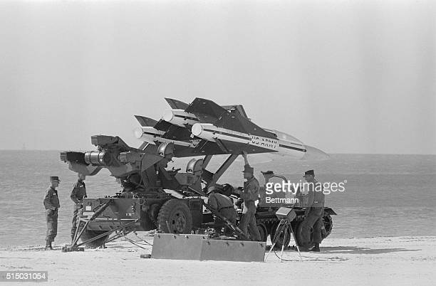 US Army antiaircraft missiles are lifted from a caterpillarwheeled vehicle to launcher on George Smathers Beach here Six launchers were armed with...