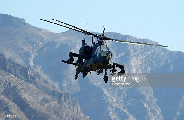 S Army Apache attack helicopter takes part in a training exercise October 22 2002 near Bagram Airbase in Afghanistan Apache helicopters are currently...