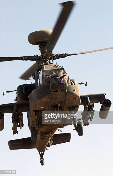 S Army Apache helicopter gunship flies November 14 2003 in Tikrit Iraq An Apache gunship killed seven people allegedly preparing to fire rockets at a...