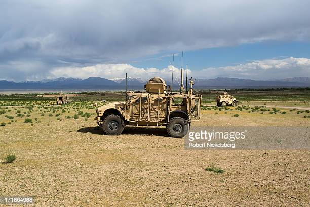 Army armored vehicles from the 4th Brigade, 3rd Infantry Division, provide security during a joint U.S. - Afghan National Army operation May 6, 2013...