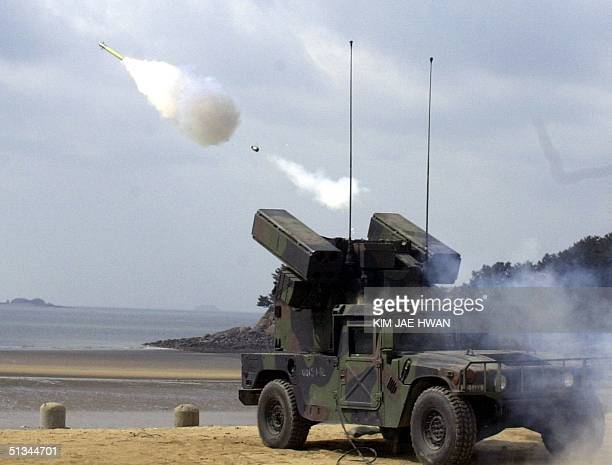 US army artillery unit fires a Stinger groundtoair missile over the Yellow Sea 08 March 2000 during a livefire exercise by US forces in Taechon on...