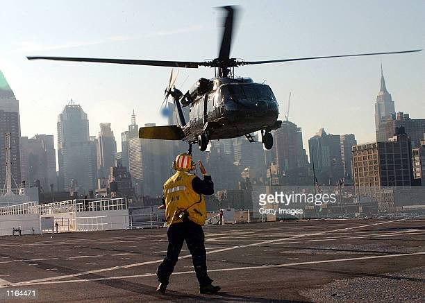 S Army Backhawk helicopter hovers as the Secretary of the Army Thomas E White rides on board September 19 2001 at the Military Sealift Command...