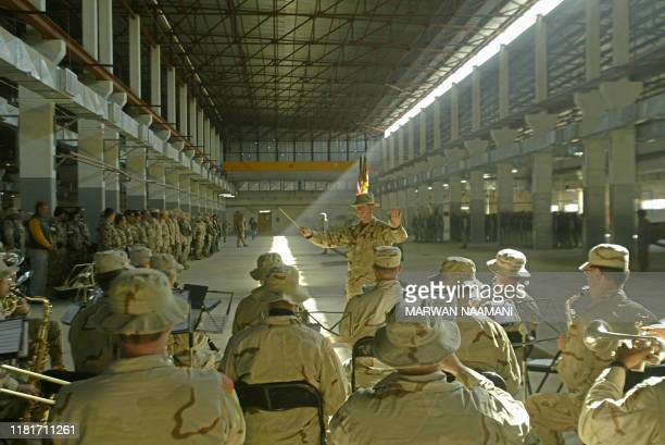 A US army band performs songs during a transfer of authority ceremony at the American base in Abu Gharib area west of Baghdad 10 February 2004 The...