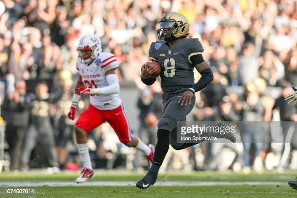 Army Black Knights quarterback Kelvin Hopkins Jr runs for a 76 yard touchdown during the Armed Forces Bowl between the Houston Cougars and Army Black...