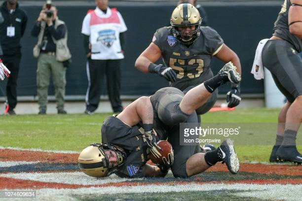 Army Black Knights running back Connor Slomka scores a touchdown during the Armed Forces Bowl between the Houston Cougars and Army Black Knights on...