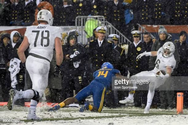 Army Black Knights running back John Trainor is stopped at the one yard line in the fourth quarter by Navy Midshipmen cornerback Elijah Merchant on...