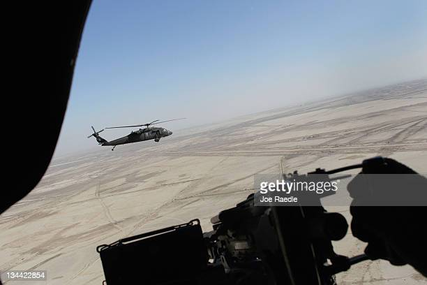 Army Blackhawk helicopter flies over the desert on December 1, 2011 near Nasiriyah, Iraq. The United States military continues its pullout of the...