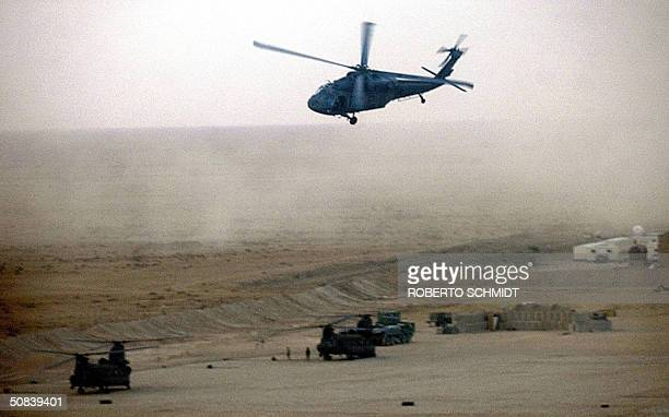 Army Blackhawk helicopter from the 1AD 2nd of the 501st Aviation Battalion Alpha company flies low as it approaches a US airfield between the Iraqi...