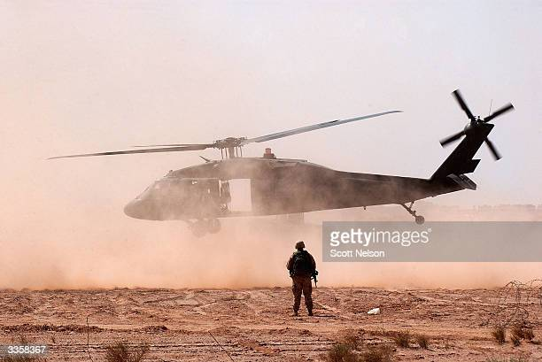 S Army blackhawk helicopter takes off from forward operating base Duke April 14 2004 about 12 miles outside the holy Iraqi city of Najaf Iraq...
