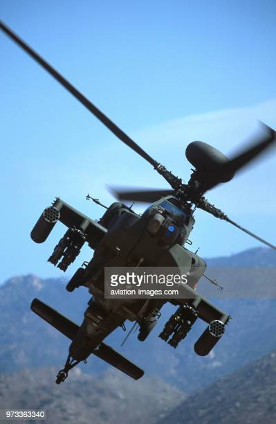 Army Boeing AH-64D Apache Longbow low-flying over the Four Peaks desert area of Tonto National Forest, flown by test pilot - Pete Nicholson.
