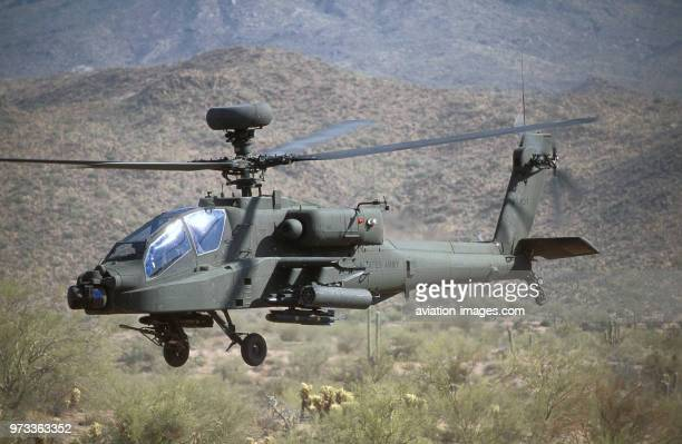 US Army Boeing AH64D Apache Longbow lowflying over the Four Peaks desert area of Tonto National Forest flown by test pilot Pete Nicholson