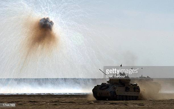 S Army Bradley fighting vehicle uses a defensive smoke screen charge to help conceal its movement during a live fire trench clearing training mission...
