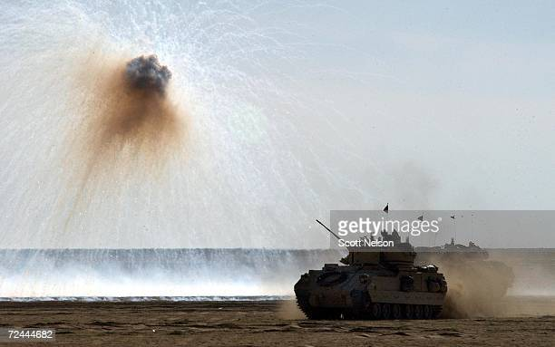 Army Bradley fighting vehicle uses a defensive smoke screen charge to help conceal its movement during a live fire trench clearing training mission...