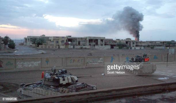 S Army Bradley fighting vehicles from the 1st Infantry Division's 2nd Battalion2nd Regiment hold a position inside a schoolyard during heavy fighting...