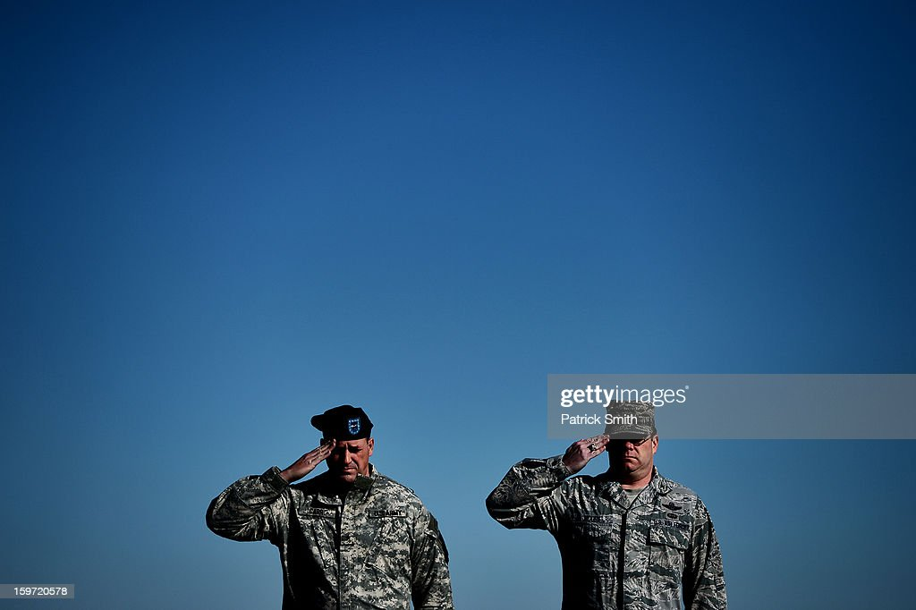 U.S. Army Brigadier Gen. Courtney P. Carr (L) and U.S. Army Col. Richard G. Moore, Jr., salute as U.S. Army soldiers carry the flag-draped transfer case containing the remains of U.S. Army Sgt. David J. Chambers, during a dignified transfer at Dover Air Force Base, on January 19, 2013 in Dover, Delaware. Chambers, who was from Hampton, Va., was killed while supporting Operation Enduring Freedom.