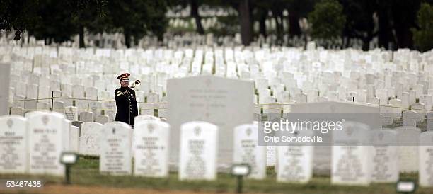 S Army bugler plays Taps during the burial services for Army Specialist Toccara R Green of Rosedale Maryland at Arlington National Cemetery August 26...