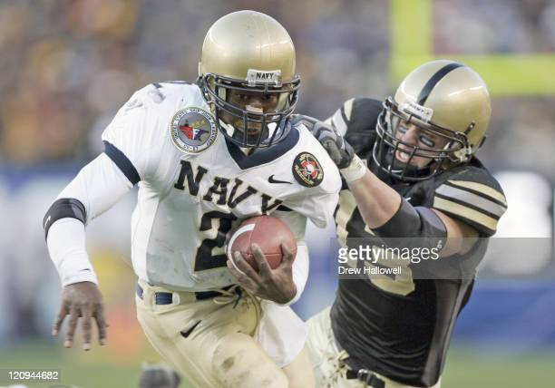 Army Cadet defensive back Caleb Campbell makes an unsuccessful attempt to bring down Navy Midshipmen quarterback Lamar Owens before making it to the...