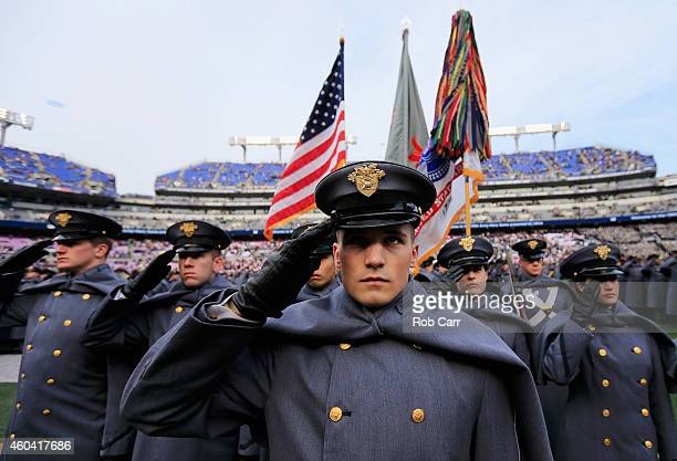 Army Cadets salute after taking the field before the start of the Army Black Knights and Navy Midshipmen game at MT Bank Stadium on December 13 2014...