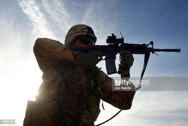 S Army Capt Greg Frey from Fredrick Maryland of the 101st Airborne fires his M4 assault weapon April 12 2002 at the firing range at Bagram Air Base...