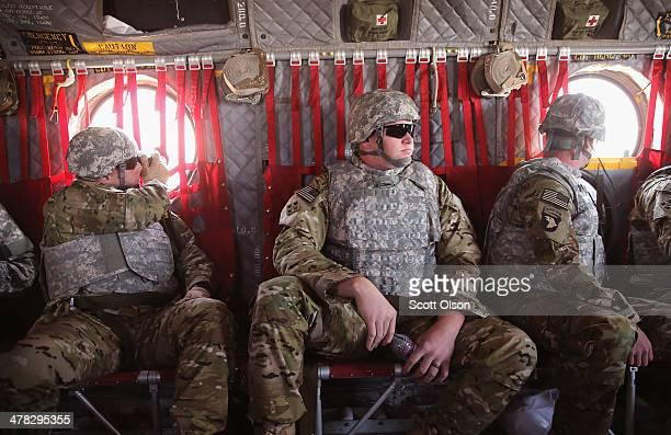 S Army Capt Matt Anderson of Richmond Virginia Sgt Daniel Harrison of Atlanta Texas and Sgt Noah Galloway of Birmingham Alabama sit aboard a...