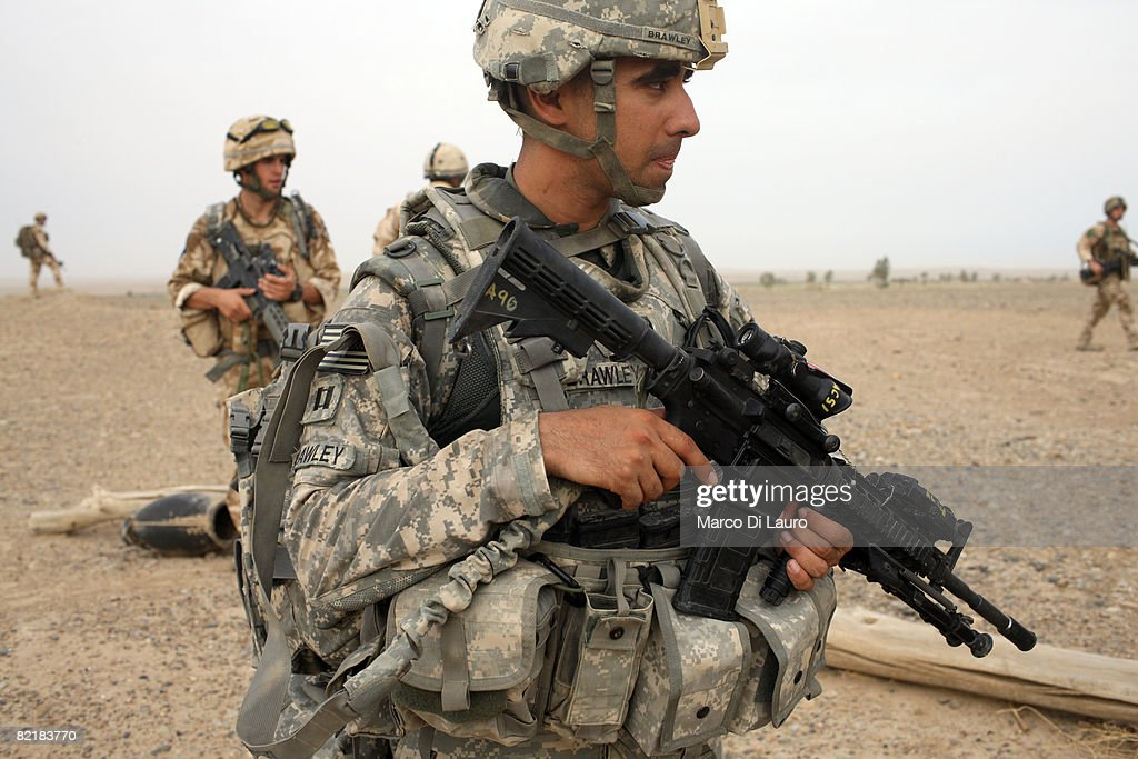 U.S Army Captain Chris Brawley, 27 from Missouri attached to British Army soldiers from the 3rd Battalion The Parachute Regiment during strike operation Southern Beast on August 4, 2008 in Maywand District in Kandahar Province, Afghanistan. The British Army soldiers from the 3rd Battalion The Parachute Regiment spearheaded a strike operation in the Maywand District of the Kandahar Province, setting the conditions for a permanent ISAF presence to support the Afghan National Government in their fight against the Taliban. Striking within one of Afghanistan's major opium producing areas the Paratroopers were looking for weapons, drugs, and individuals related to the Taliban. During the operation about seventy kilograms of opium was seized and some weapons were recovered.