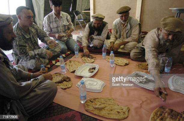 Army Captain Dennis Sugrue, of Watertown, New York, meets with elders from Kamdesh District of Nuristan, to discuss projects in their villages...