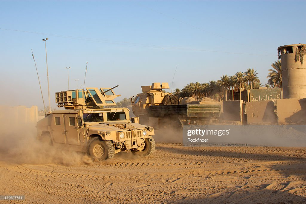 Army car going to its base on a dirty road : Stock Photo