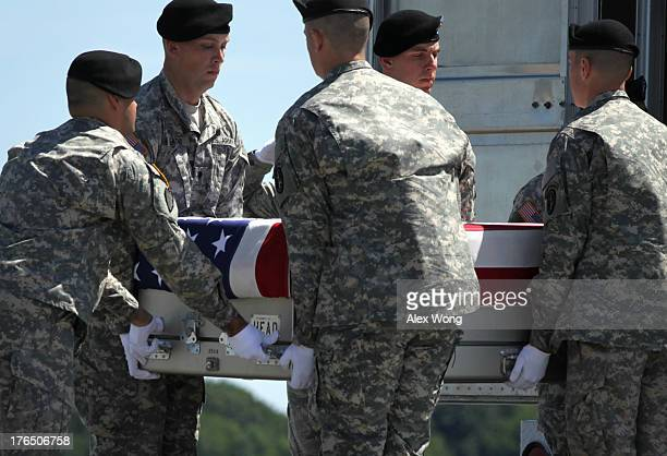 S Army carry team carries the flagdraped transfer case with the remains of Army Staff Sergeant Octavio Herrera of Caldwell Idaho into a transfer...