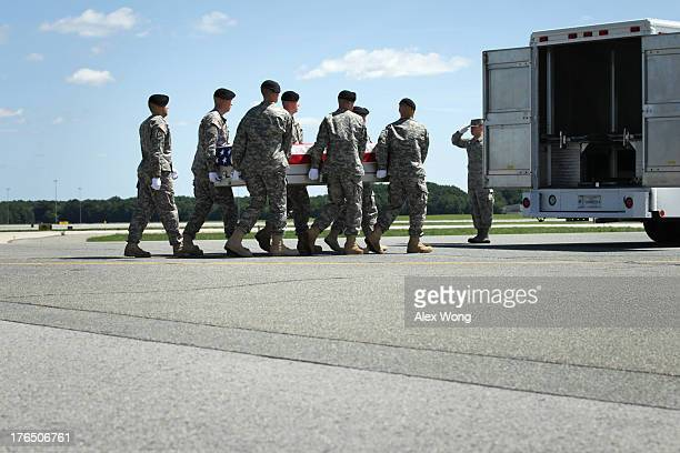 S Army carry team carries the flagdraped transfer case with the remains of Army Staff Sergeant Octavio Herrera of Caldwell Idaho across the tarmac...