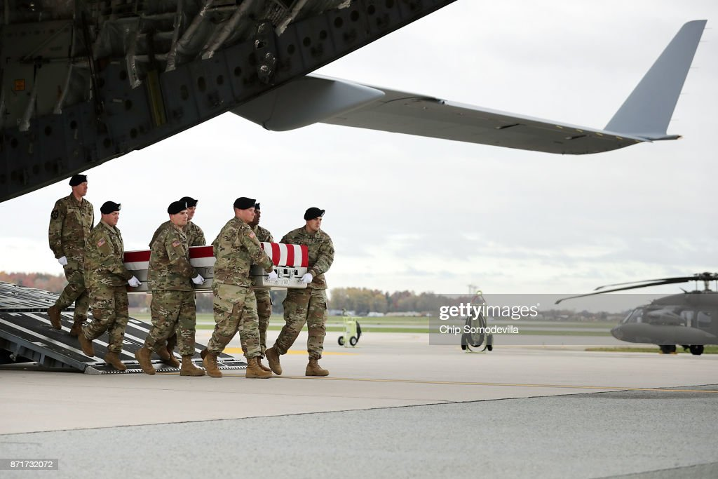 S. Army cary team carries the flag-draped transfer case containing the remains of Sgt. 1st Class Stephen B. Cribben during his dignified transfer at Dover Air Force Base November 8, 2017 in Dover, Delaware. Assigned to the 2nd Battalion, 10th Special Forces Group, Cribben, 33, was killed in Logar, Afghanistan, when his unit was engaged in what the Pentagon calls 'combat operations.'