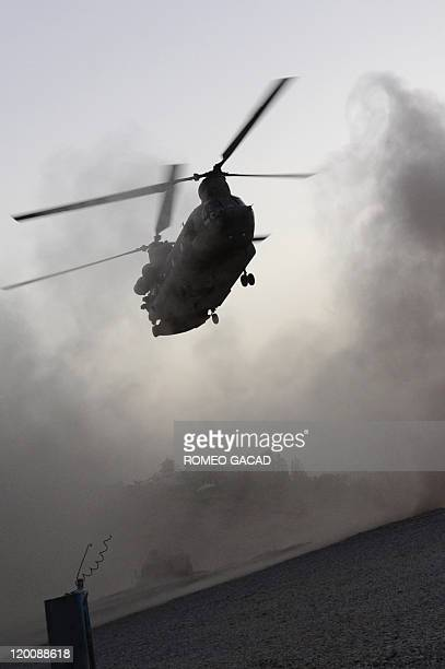 Army CH47 Chinook helicopter lands at a forward base in Arghandab district while transporting troops around southern Afghanistan on July 29 2011 All...