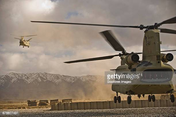 U.S. Army CH-47 Chinook helicopters depart a military base in Afghanistan.