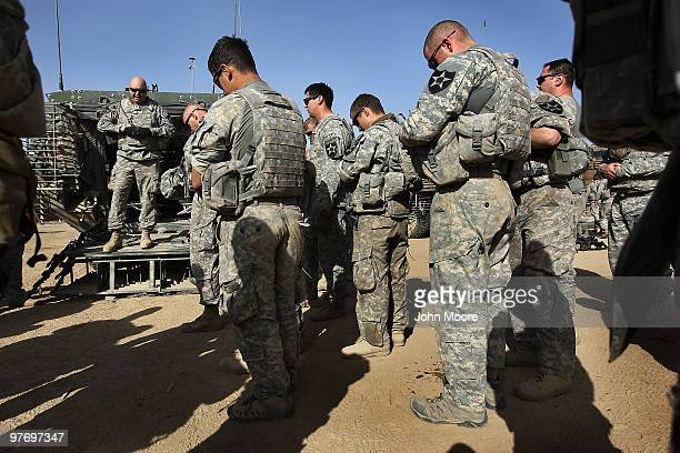 S Army Chaplain Carl Subler prays with soldiers before a military operation on March 14 2010 at HowzeMadad in Kandahar province Afghanistan He...