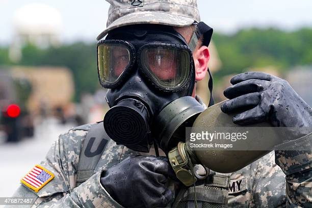 U.S. Army chemical operations specialist takes a break for water.