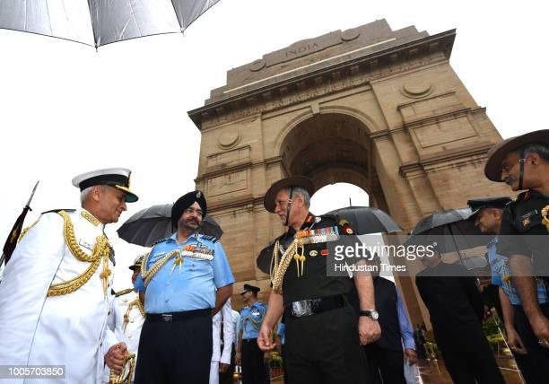 Army chief General Bipin Rawat Navy chief Admiral Sunil Lanba Indian Air Force Air Chief Marshal BS Dhanoa after paying tributes at Amar Jawan Jyoti...