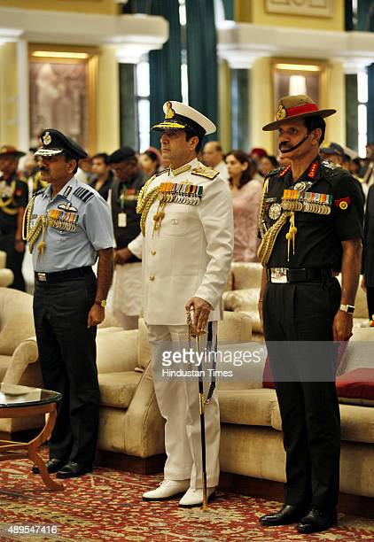 Army Chief General Dalbir Singh Navy Chief Admiral RK Dhowan Air Chief Marshal Arup Raha stand for National Anthem during the golden jubilee of 1965...