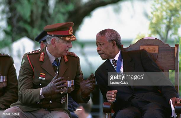 Army Chief General George Meihirg Head of Armed Forces makes a point to Nelson Mandela Former President of South Africa and longtime political...
