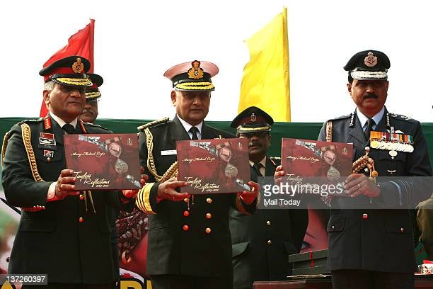 Army Chief General VK Singh Navy Chief Admiral Nirmal Verma and Air Chief Marshal NAK Browne Chief of Air Staff release a book after Army Day Parade...