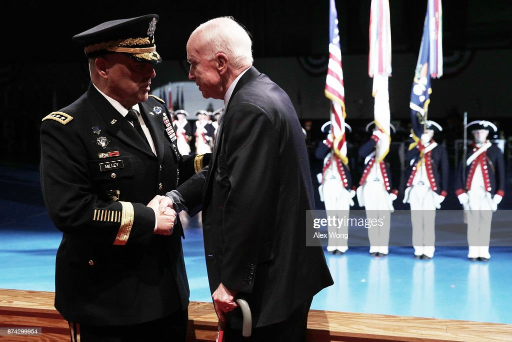 U.S. Army Chief of Staff Gen. Mark A. Milley (L) greets Sen. John McCain (R-AZ) (R) during a special Twilight Tattoo performance November 14, 2017 at Fort Myer in Arlington, Virginia. Sen. McCain was honored with the Outstanding Civilian Service Medal for over 63 years of dedicated service to the nation and the U.S. Navy.