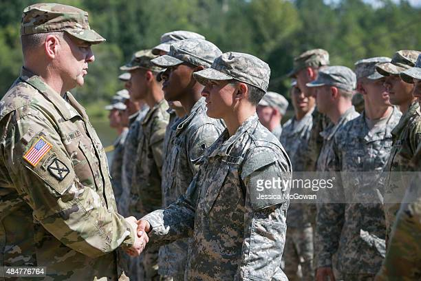 Army Chief of Staff Gen Mark A Milley shakes hands and congratulates Capt Kristen Griest during the graduation ceremony of the United States Army's...