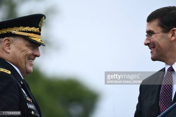 US Army Chief of Staff Gen Mark Milley speaks with Secretary of Defense Mark Esper during the Armed Forces Welcome Ceremony in honor of the Twentieth...