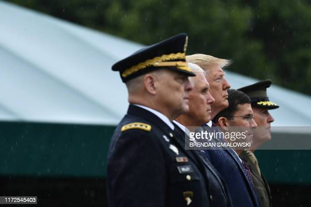 US Army Chief of Staff Gen Mark Milley stands with US President Mike Pence US President Donald Trump US Secretary of Defense Mark Esper and Gen...