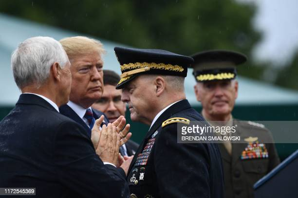 US Army Chief of Staff Gen Mark Milley walks by US President Donald Trump during the Armed Forces Welcome Ceremony in honor of the Twentieth Chairman...